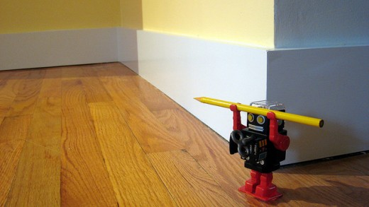 Dust Baseboards with Dryer Sheets to Keep them Cleaner Longer