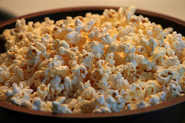Pop Salty Popcorn in a Stainless Steel Bowl